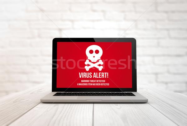 computer on a table virus Stock photo © georgejmclittle