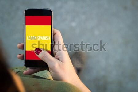 Femme séance rue smartphone apprentissage Photo stock © georgejmclittle