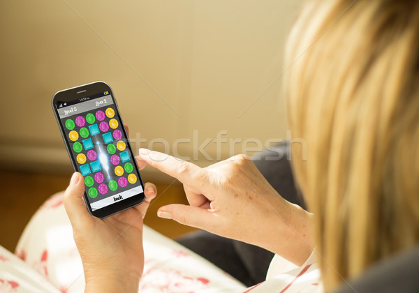 Technology woman gaming smartphone Stock photo © georgejmclittle