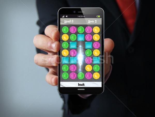 Videojáték üzletember okostelefon új technológiák üzlet Stock fotó © georgejmclittle