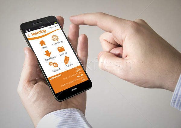 touchscreen smartphone with e-learning site on the screen Stock photo © georgejmclittle