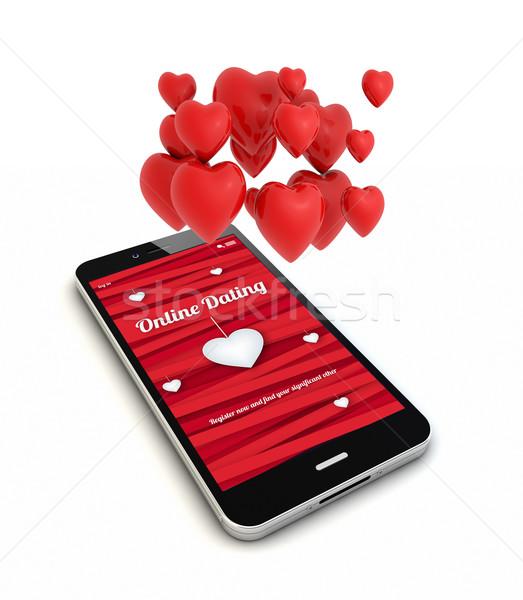 смартфон онлайн знакомства оказывать сердцах воздуха Сток-фото © georgejmclittle