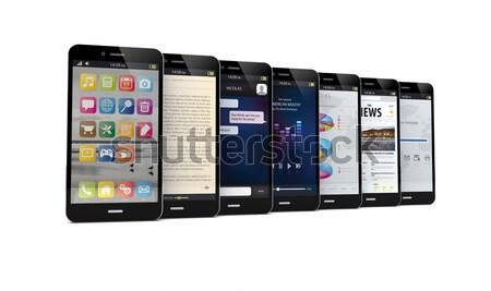 Trois smartphones différent applications écran Photo stock © georgejmclittle