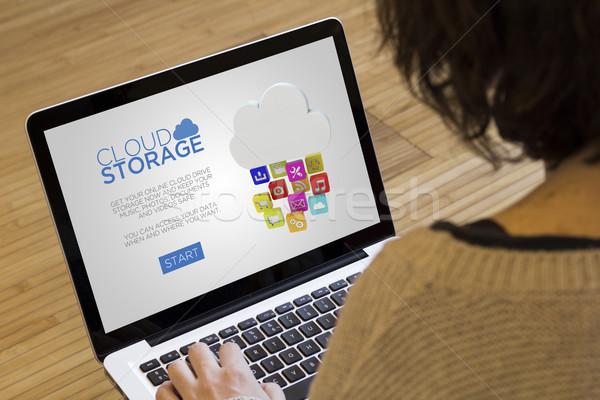 Ordinateur femme nuage stockage disque portable écran Photo stock © georgejmclittle
