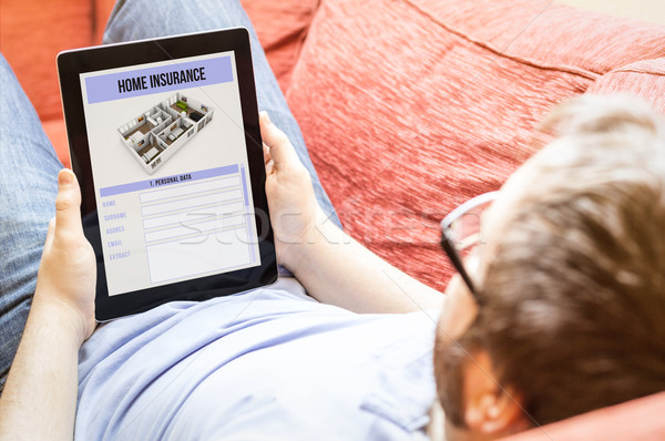 Kanepe ev sigortası tablet teknoloji yaşam tarzı Stok fotoğraf © georgejmclittle