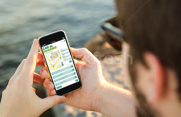 Homme téléphone portable côte voiture app Photo stock © georgejmclittle