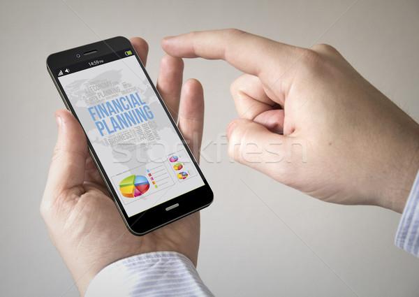 écran tactile smartphone planification financière écran homme Photo stock © georgejmclittle