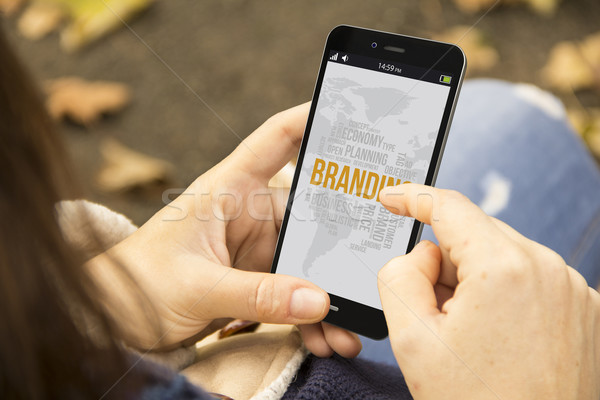 woman with mobile branding in the park Stock photo © georgejmclittle