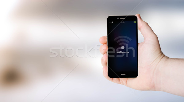 no network phone on user´s hand Stock photo © georgejmclittle
