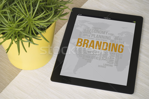 Tablet branding over a table with plant Stock photo © georgejmclittle