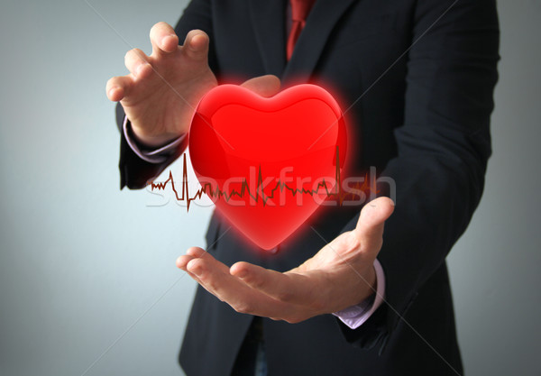 Seguro de saúde amor conceito mãos empresário saúde Foto stock © georgejmclittle