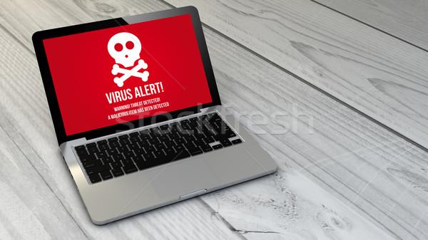 virus laptop over wooden tablet Stock photo © georgejmclittle