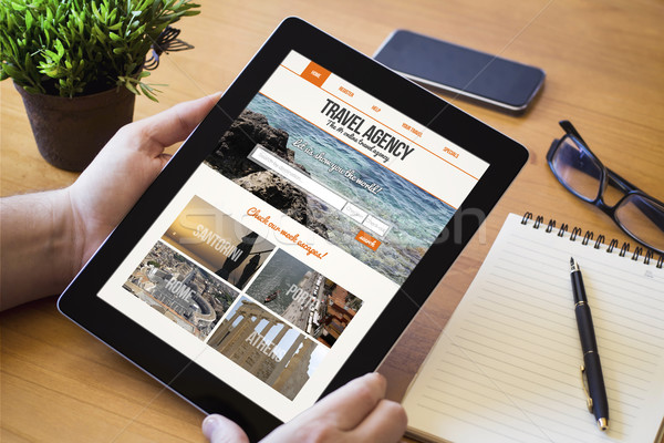 Stock photo: desktop tablet travel agency website on screen