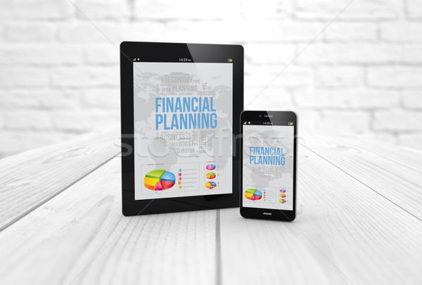 Planification financière comprimé smartphone mobiles bureau Photo stock © georgejmclittle