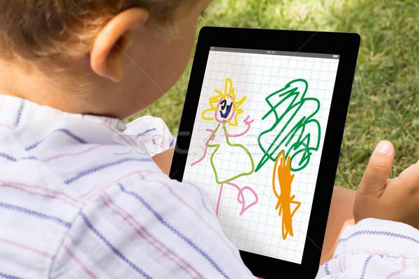Garçon dessin comprimé Kid app ordinateur Photo stock © georgejmclittle