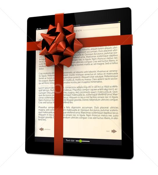 Cadeau livre électronique ruban ordinateur fond Photo stock © georgejmclittle