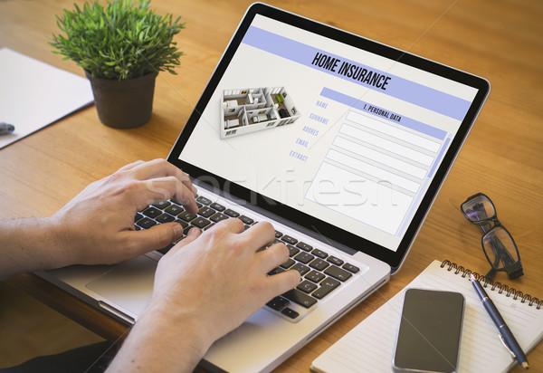 Bilgisayar masaüstü ev sigortası işadamı çalışmak Stok fotoğraf © georgejmclittle