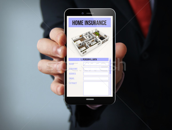 home insurance businessman smartphone Stock photo © georgejmclittle