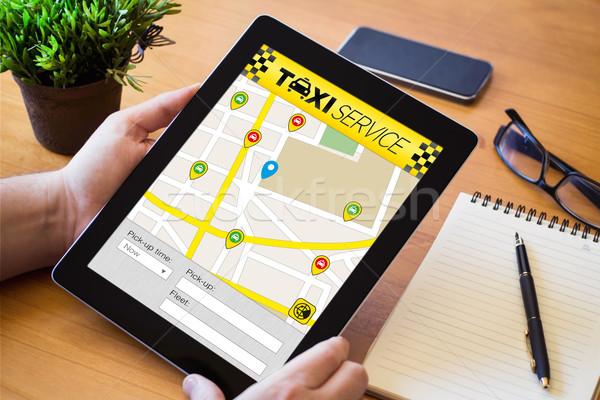 Taxi app comprimé bois mains Photo stock © georgejmclittle