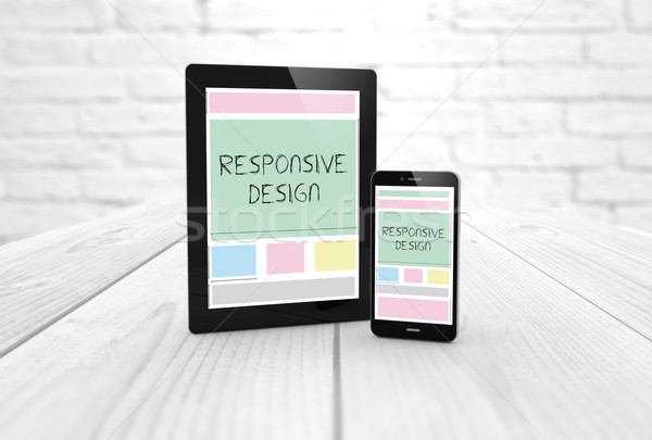 responsive design wireframe on a laptop display and smartphone Stock photo © georgejmclittle
