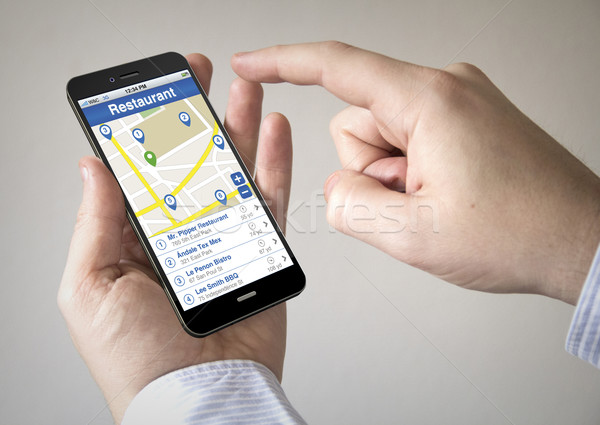 touchscreen smartphone with restaurant seeker on the screen Stock photo © georgejmclittle
