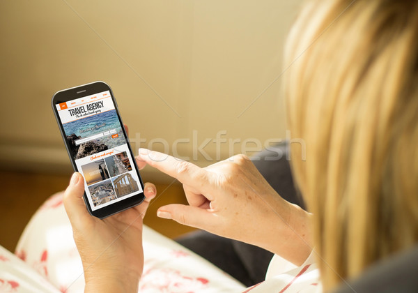 Technology woman travel agency website on screen Stock photo © georgejmclittle