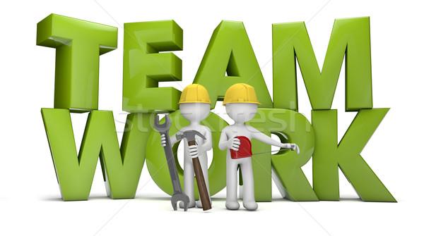 Takım çalışması vermek iki işçiler metin el Stok fotoğraf © georgejmclittle