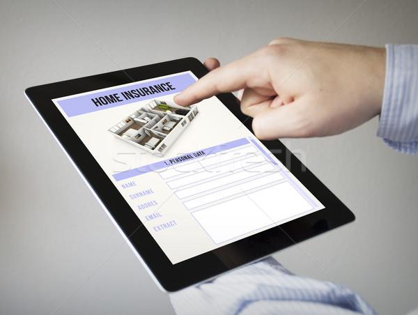 Ev sigortası tablet yeni eller dokunmatik ekran Stok fotoğraf © georgejmclittle