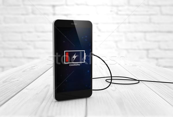 charging smart phone Stock photo © georgejmclittle