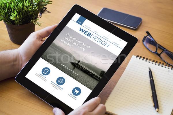 Bureau comprimé web design mains homme Photo stock © georgejmclittle
