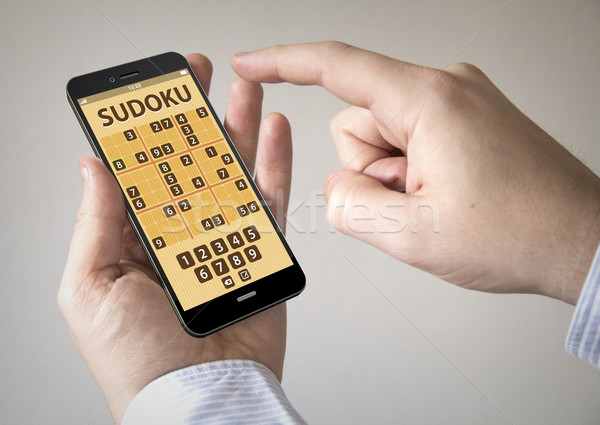 touchscreen smartphone with sudoku game application on the scre Stock photo © georgejmclittle
