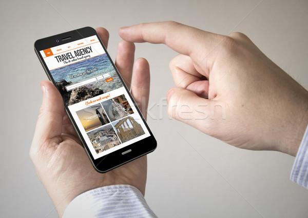 écran tactile smartphone écran homme Photo stock © georgejmclittle