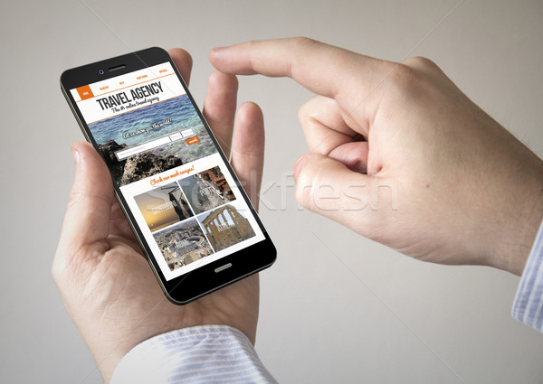 смартфон бюро путешествий экране человека Сток-фото © georgejmclittle