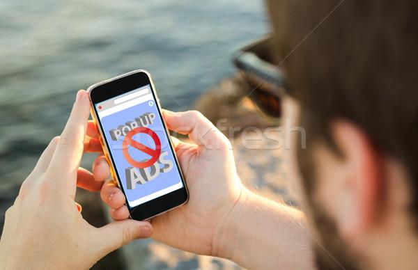 Homme téléphone portable côte smartphone tous Photo stock © georgejmclittle