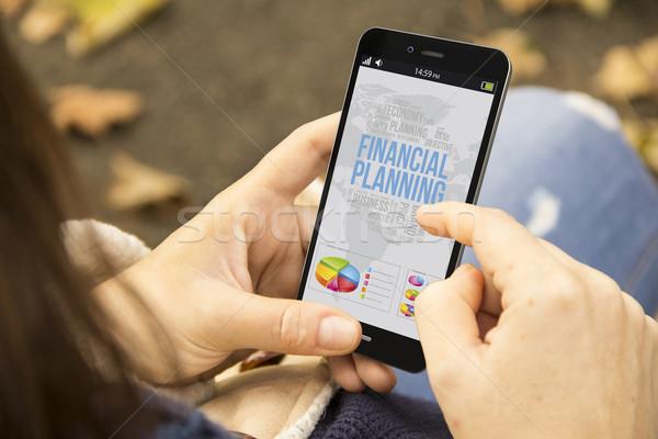 Femme planification financière téléphone parc femme d'affaires Photo stock © georgejmclittle