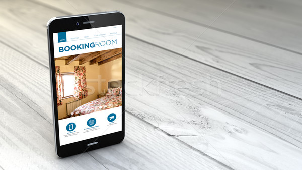 smartphone with booking website over white wooden background Stock photo © georgejmclittle