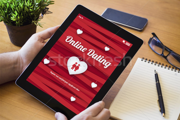 desktop tablet online dating Stock photo © georgejmclittle