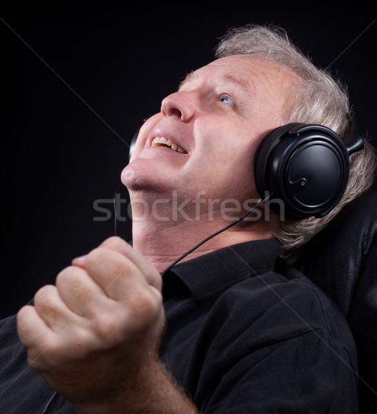 Intenzív érzelem boldog idős hallgat valami Stock fotó © georgemuresan