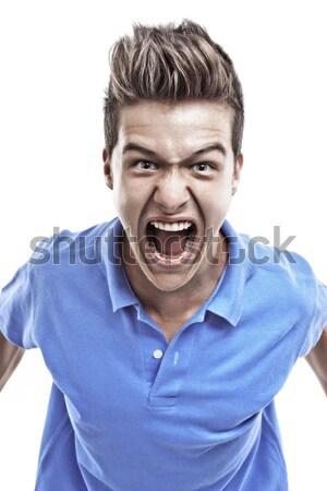 Fiatalember sikít mérges kék blúz kiált Stock fotó © georgemuresan
