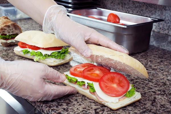 Szendvicsek előkészítés séfek kezek kereskedelmi konyha Stock fotó © georgemuresan