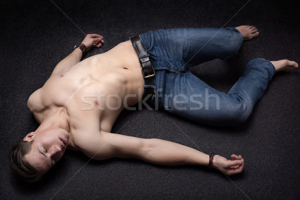 Laying down sportsman Stock photo © georgemuresan