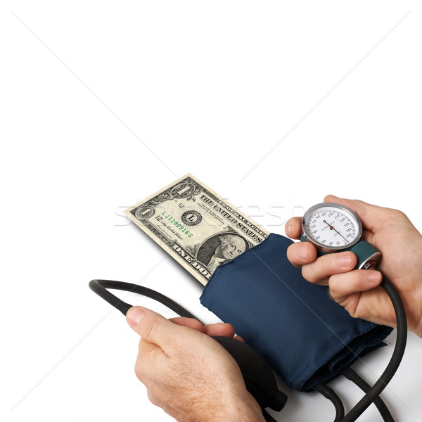 Doctor taking pressure of one dollar. Concept for dollar crisis. Stock photo © georgemuresan