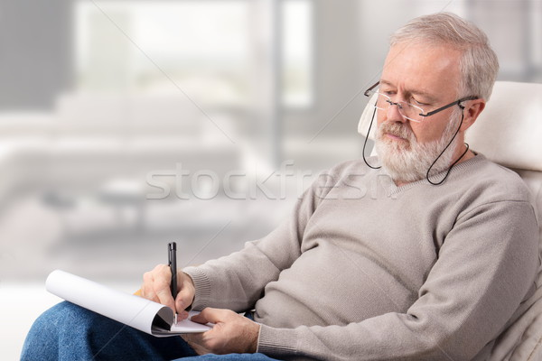 Man making the shopping list for holidays Stock photo © georgemuresan