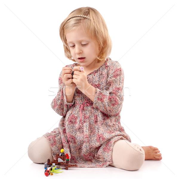 Jouer avec prudence fille faible jouets Photo stock © georgemuresan