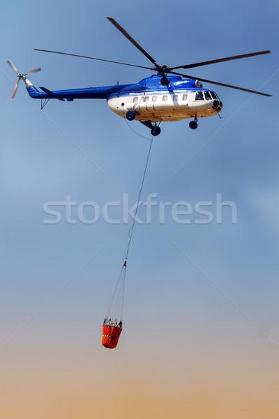 Fogo lutador azul resgatar helicóptero água Foto stock © georgemuresan