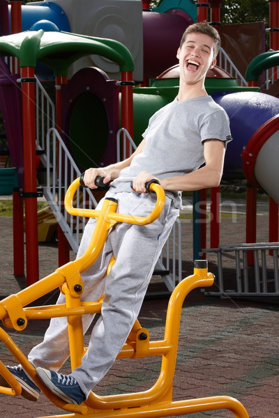 Moço fitness máquina primavera esportes Foto stock © georgemuresan