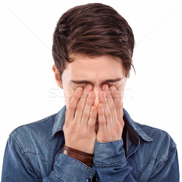 молодым человеком сокрытие лице рук печально портрет Сток-фото © georgemuresan