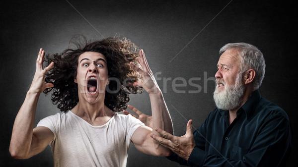 Hijo papá mirando abajo enojado Foto stock © georgemuresan