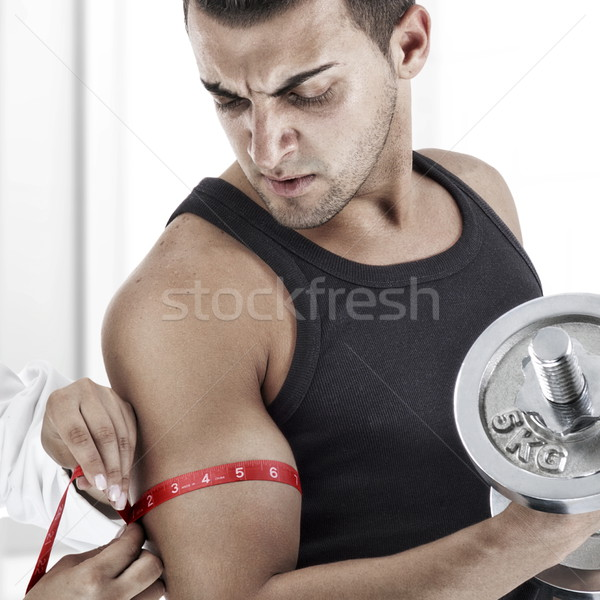 Entrenamiento enfermera bíceps hombre guapo edificio Foto stock © georgemuresan