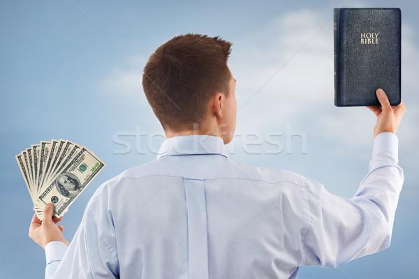 Duro elección joven dios dinero Foto stock © georgemuresan